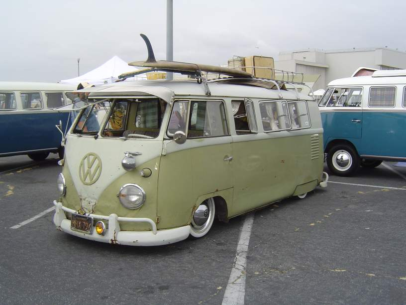 While a little beat up this VW Bus/van is flying both the stance and hippy flag