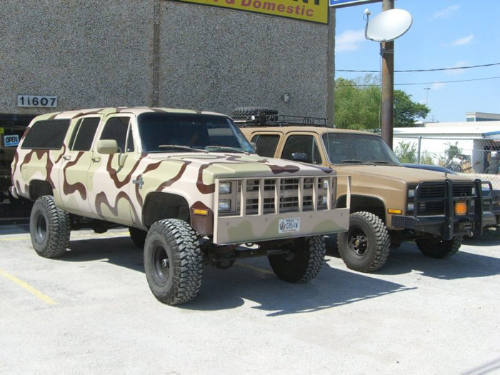 Two full size lifted Suburbans