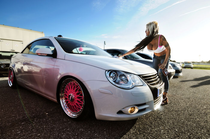 This owner uses pink accents to set off her modifications