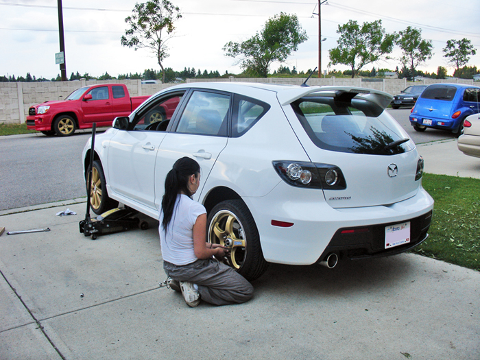 The owner putting on her first set of wheels  pre wide body