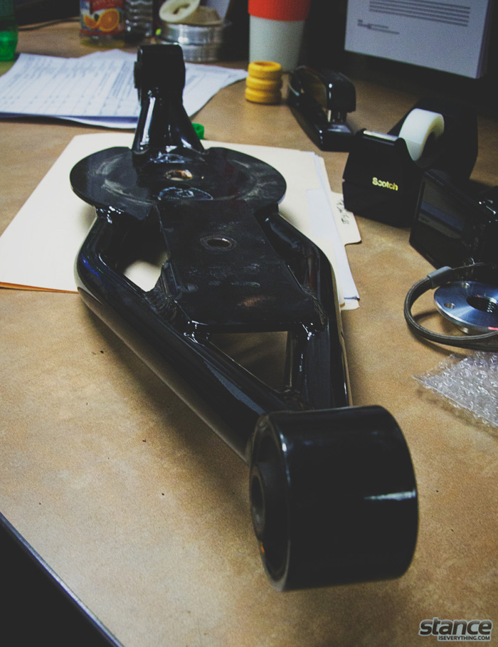 A Mazda 3 prototype trailing arm on Ian's desk