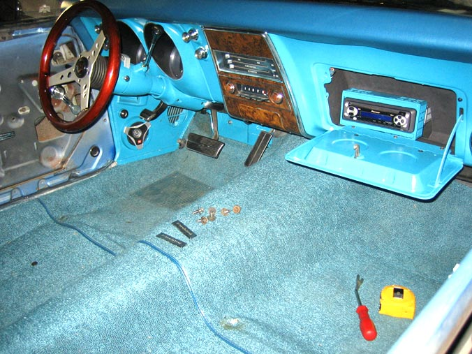 The interior colors were restored to factory and an mp3 player was installed in the glove box to keep the original look, note the colored JBLs as  well