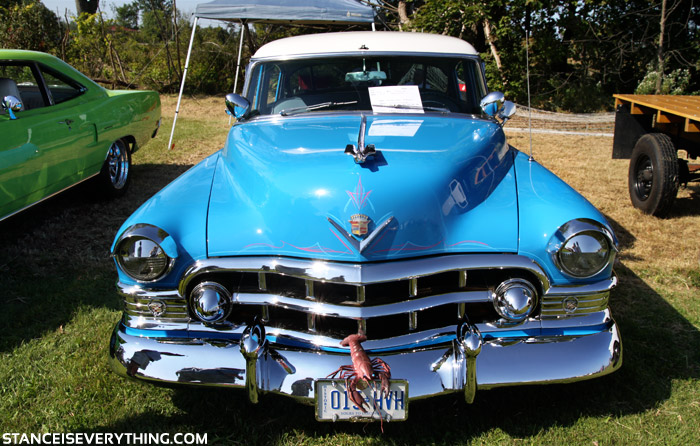The pinstripe and chrome really enhance the blue paint on this old Cadillac