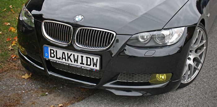 BMW-oem lip kit, blacked out grills, and yellow fogs finish up the front end