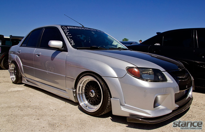 2013_stretch_and_poke_fitted_mazda_protege